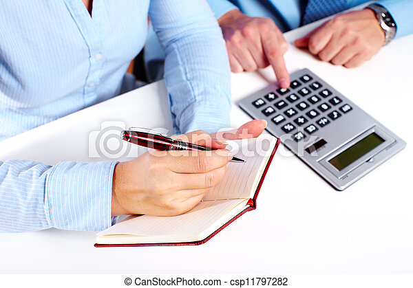 Hands of business person working with calculator. - csp11797282