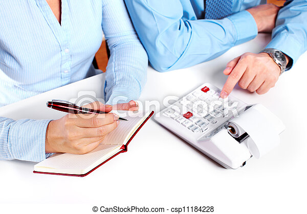 Hands of business person working with calculator. - csp11184228