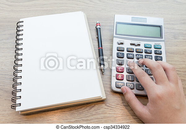 Hands of business woman working with calculator. - csp34334922