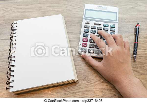 Hands of business woman working with calculator - csp33716408