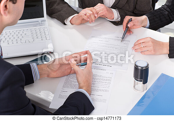 hands of three people, signing documents - csp14771173