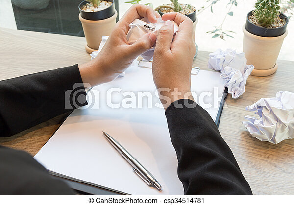 Hands of woman crumple sheets of Resume at the desk, mistake resume - csp34514781