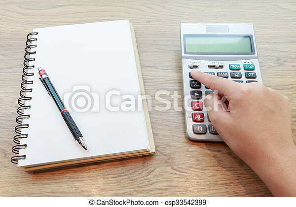Hands of woman Working with Calculator - csp33542399