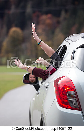 hands out of a car window - csp84057122
