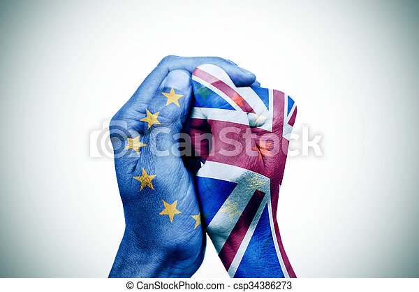 hands patterned with the European and the British flag put together - csp34386273