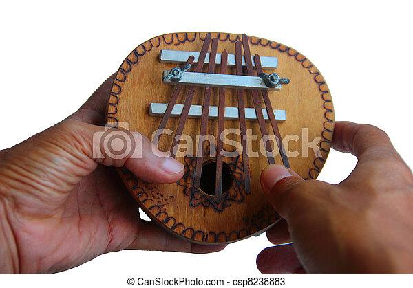 Hands play kalimba