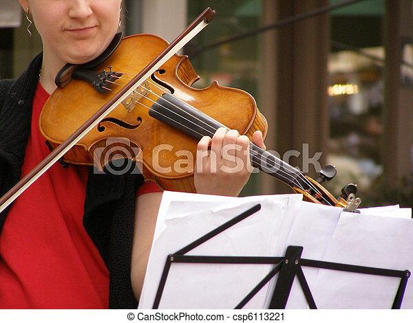 hands playing violin - csp6113221