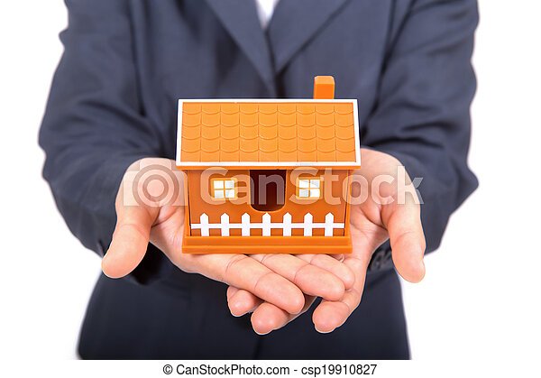 Hands presenting a small model of a house - csp19910827