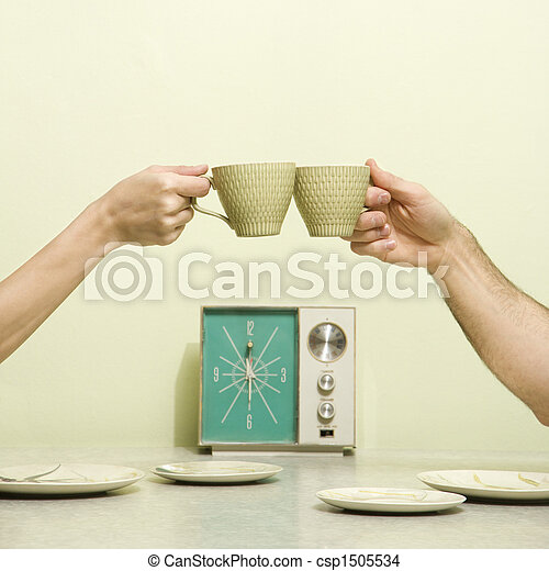 Hands toasting cups. - csp1505534