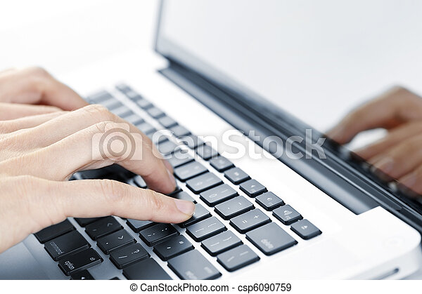 Hands typing on laptop keyboard - csp6090759