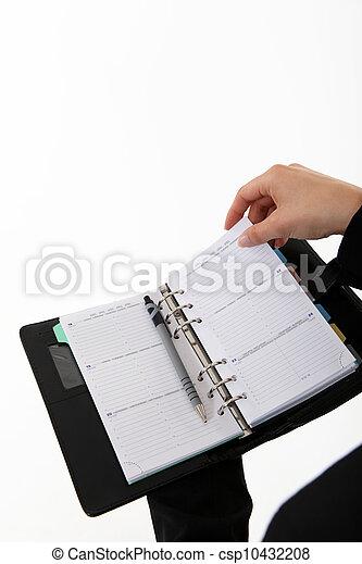 Hands with calendar - csp10432208