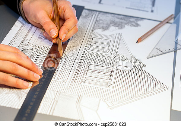Hands working on construction layout project. - csp25881823