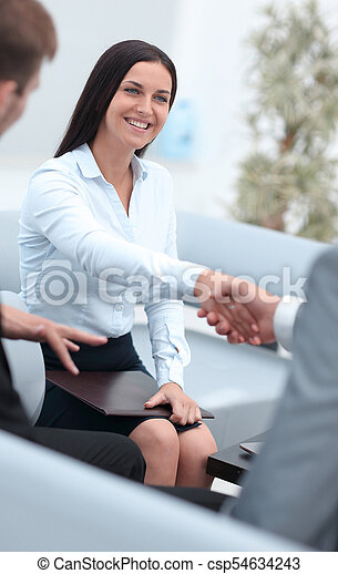 handshake business partners in the office. - csp54634243