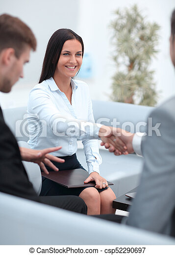 handshake business partners in the office. - csp52290697