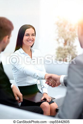 handshake business partners in the office. - csp55442605