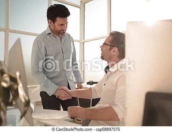 handshake business people in a modern office. - csp58897375