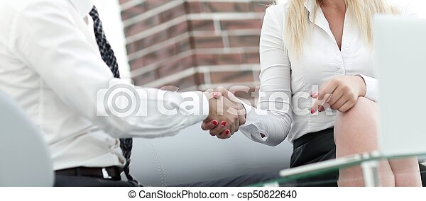 handshake business people in the office - csp50822640