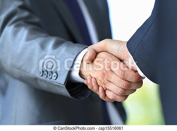 handshake in office - csp15516061