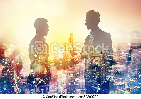 Handshake of two businessperson in office with network effect. concept of partnership and teamwork - csp50309723