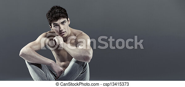 Handsome athlete with curly hair - csp13415373