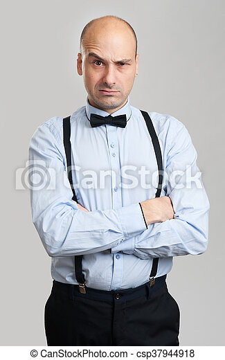 2f14a05caa61 Handsome bald man raised eyebrow. Handsome stylish bald man raised ...