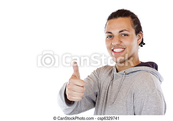 Handsome black coloured teenager holds thumb up. - csp6329741