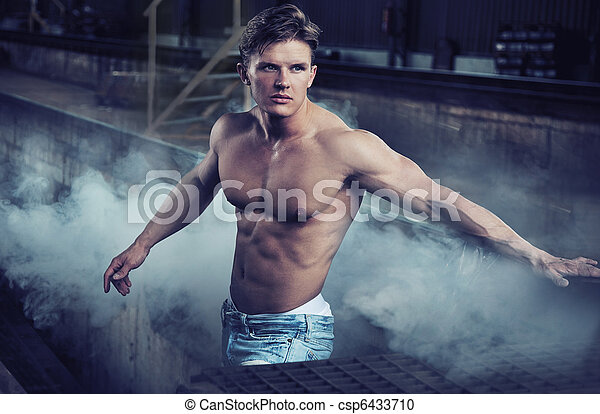 Handsome bodybuilder wearing jeans - csp6433710