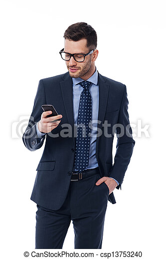 Handsome businessman checking emails on the phone - csp13753240