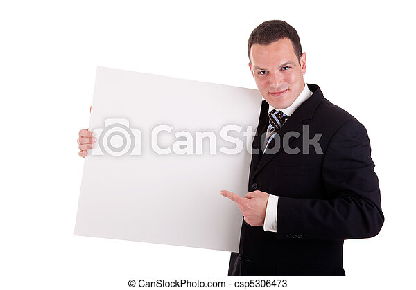 handsome businessman holding a whiteboard and pointing, looking at the  camera and smiling, isolated on white, studio shot