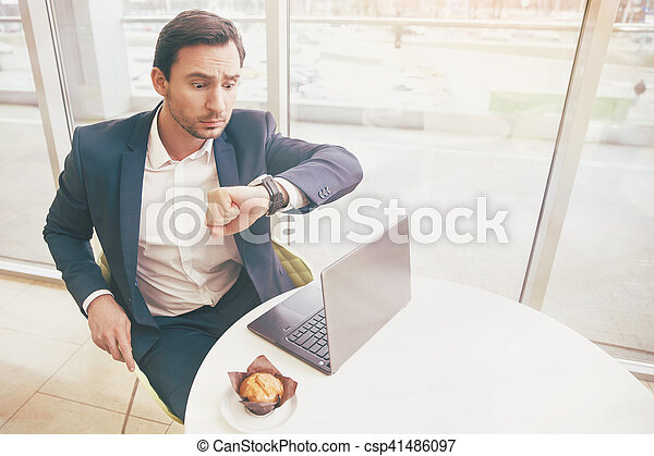 Handsome Businessman In Classic Costume Looking At Watches
