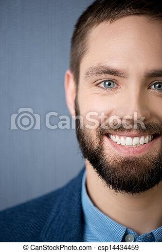 Handsome Businessman Smiling - csp14434459