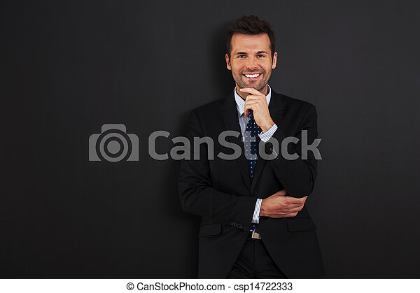 Handsome businessman standing at the blackboard  - csp14722333