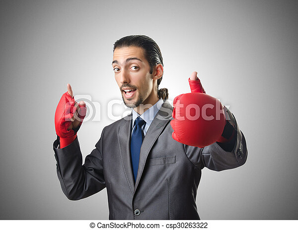 Handsome businessman with boxing gloves - csp30263322