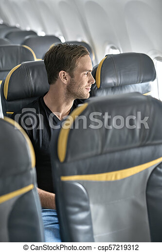 Handsome Guy In Airplane Happy Man Sits In The Airplane Next To