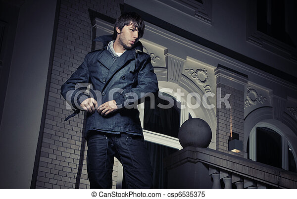 Handsome guy in front of a luxury house - csp6535375