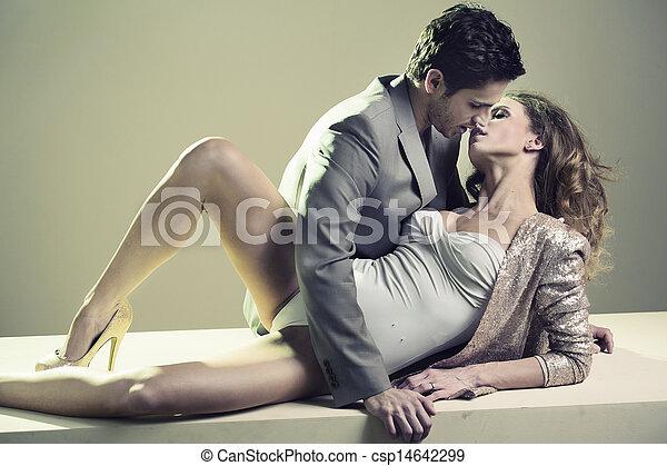 Handsome guy kissing his beloved girlfriend - csp14642299