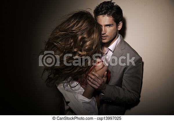 Handsome guy with his sensual girlfriend - csp13997025