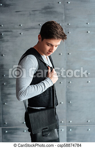handsome guy with leather bag - csp58874784