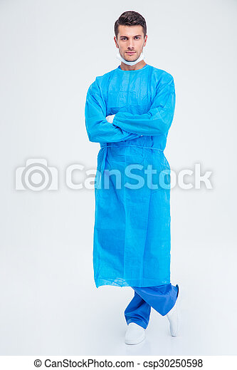 Handsome male surgeon standing with arms folded  - csp30250598
