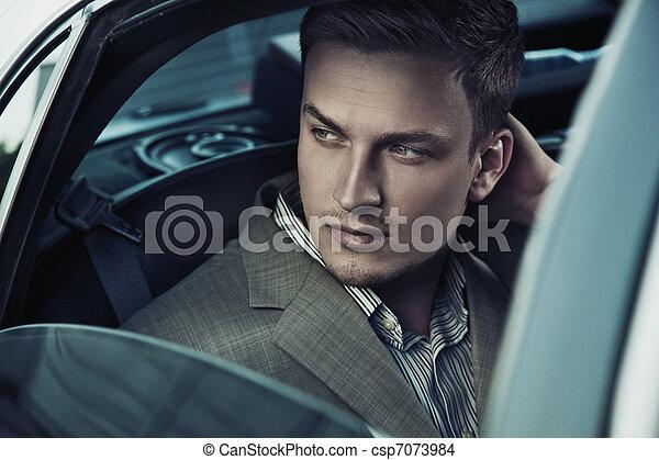 Handsome man in car - csp7073984