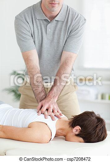 Handsome Man massaging a cute woman's neck - csp7208472