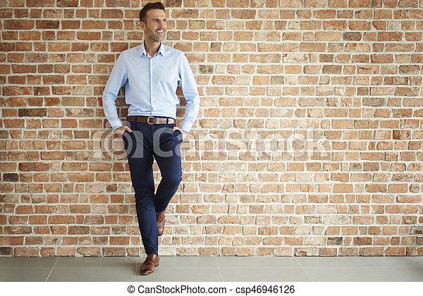 Handsome man on brick wall - csp46946126