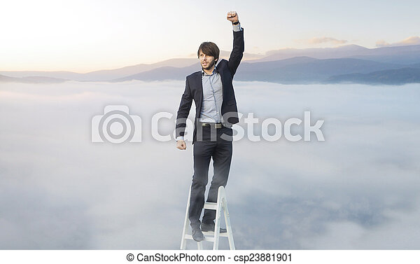 Handsome man on the ladder above the clouds - csp23881901