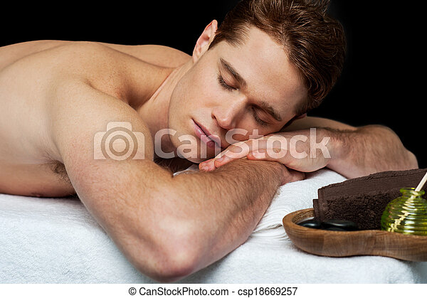Handsome man relaxing at the spa - csp18669257