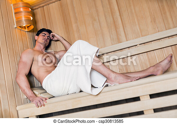 Handsome man relaxing in a sauna - csp30813585