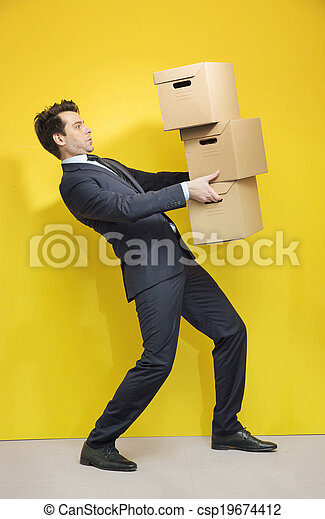 Handsome manager carrying the paper boxes - csp19674412