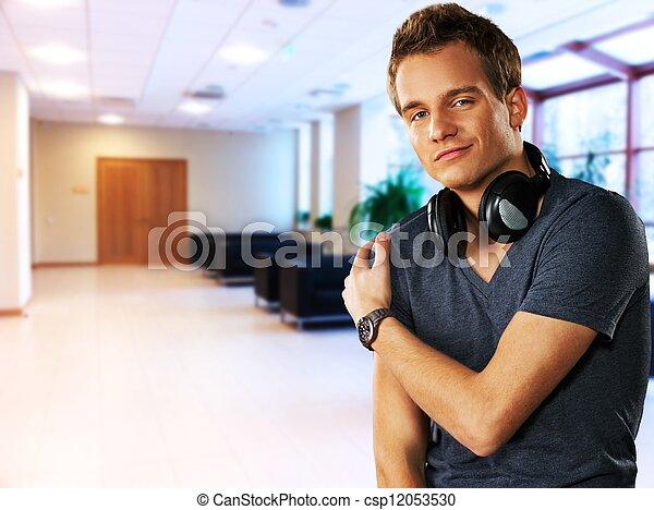 Handsome men with headphones indoors - csp12053530