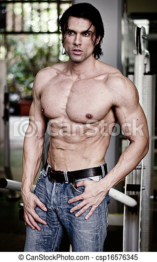 Handsome muscular man in jeans shirtless looking away - csp16576345