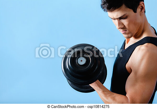 Handsome muscular man uses his dumbbell - csp10814275