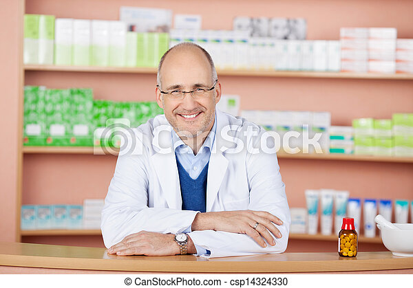 Handsome pharmacist in drugstore - csp14324330